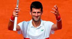Novak Djokovic gestures to fans after winning his second round match at the French Open. Photo: Christophe Ena/AP