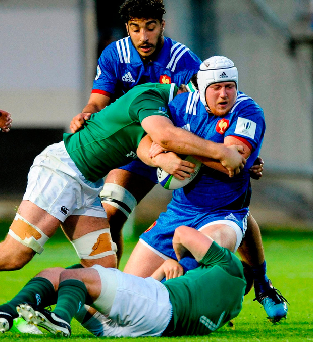 France's Daniel Brennan is tackled by Caelan Doris of Ireland. Photo: Pascal Rodriguez/Sportsfile