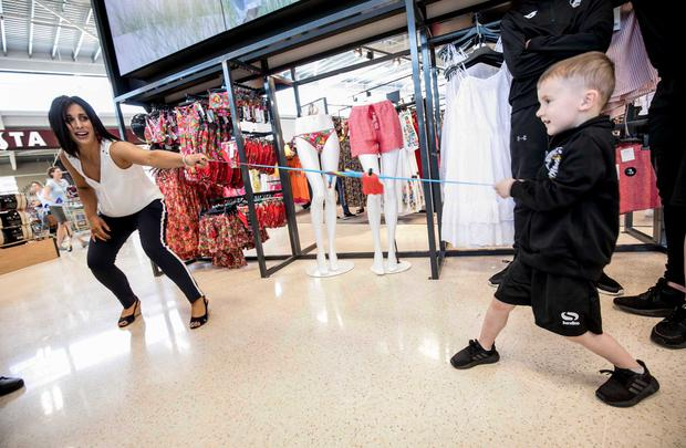 TV presenter Lucy Kennedy, with four-year-old Jaden Somers, as the opening of Tesco's new €30 million store in Liffey Valley. Picture: Chris Bellew /Fennell Photography