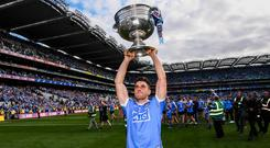 Bernard Brogan, here with the Sam Maguire after last year's All-Ireland final, is determined to recover from his cruciate injury and play again for Dublin. Photo: Stephen McCarthy/Sportsfile