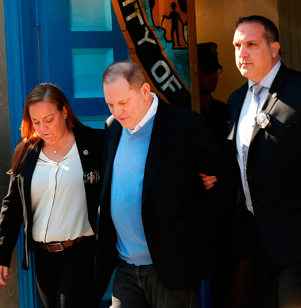 Harvey Weinstein is led out of the NYPD's First Precinct in handcuffs after his arrest on charges of rape, committing a criminal sex act, sexual abuse and sexual misconduct. Photo: Spencer Platt/Getty Images