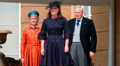 Princess Eugenie (C) with the Duke and Duchess of Gloucester attend a Garden Party at Buckingham Palace on May 31, 2018 in London, England. (Photo by Yui Mok - WPA Pool/Getty Images)