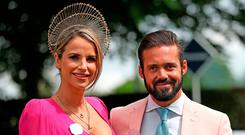Vogue Williams and Spencer Matthews during ladies day of the 2018 Investec Derby Festival at Epsom Downs Racecourse, Epsom