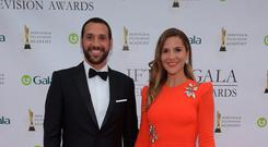 Julian Okines and Amanda Byram arriving on the red carpet for the IFTA