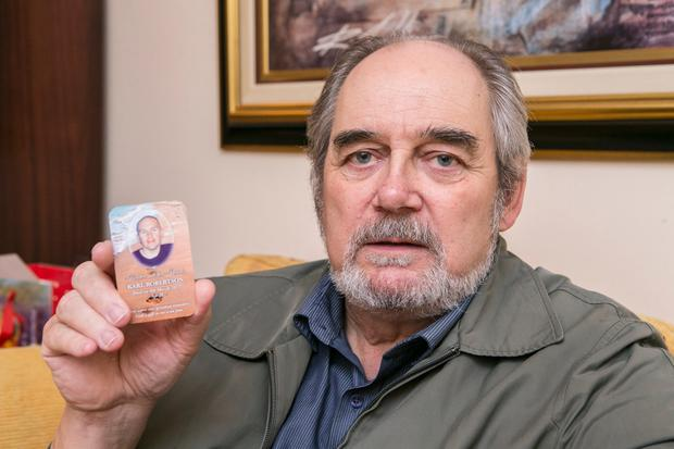Fred Reid with a photo of Karl Robertson his Nephew who was killed in a hit and run. Photo: Kyran O'Brien