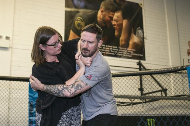 Laura Lynott and coach John Kavanagh get to grips with self-defence at SBG Gym on the Naas Road, Dublin. Photo: Mark Condren