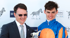 Donnacha O'Brien with his father Aidan after partnering Forever Together to victory in the Oaks at Epsom. Photo: PA