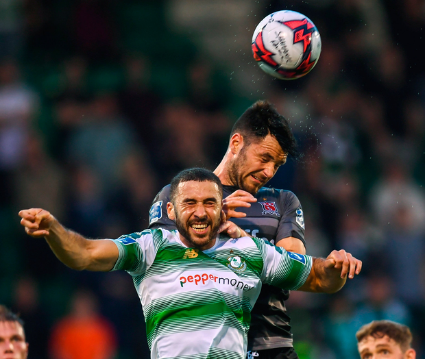 Dundalk's Patrick Hoban heads his side's first goal despite the attention of Shamrock Rovers' Roberto Lopes. Photo: Sportsfile