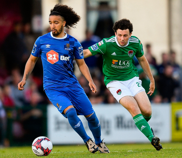 Waterford's Bastien Héry keeps possession ahead of Cork City's Barry McNamee. Photo: Sportsfile