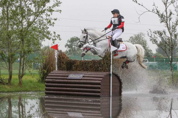 Young Irish rider Daniel Meagher and his pony Monroe Lad takes a spectacular leap at one of the water jumps at the Tattersalls International Horse Trials &Country Fair. Photo: Radka Preislerova