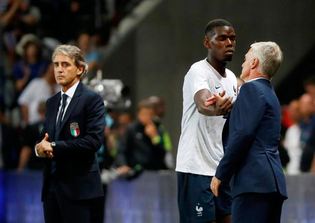 Didier Deschamps shakes the hand of Paul Pogba as he is substituted