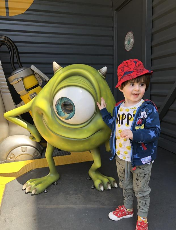 Oscar poses with Monsters Inc.'s Mike Wazowski during a family holiday. Photo: Yavanna Keogh