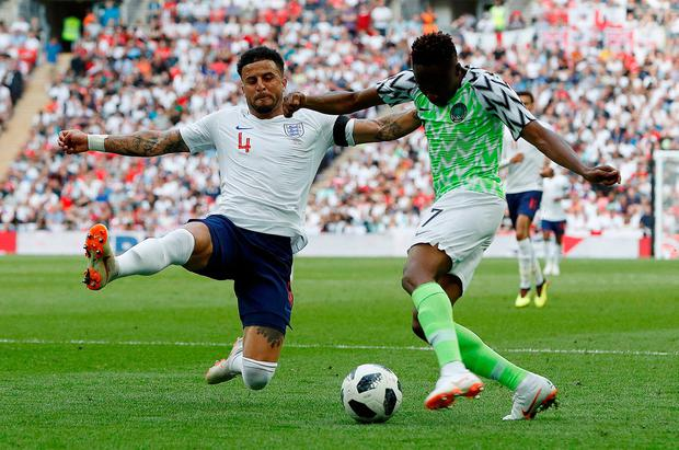 Nigeria's Ahmed Musa battles with England's Kyle Walker. Photo: Darren Staples/Reuters