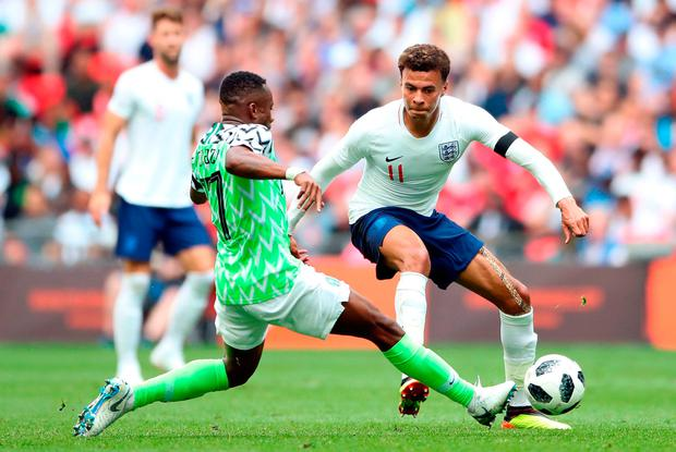 England's Dele Alli (right) and Nigeria's Ogenyi Onazi battle for the ball during the International Friendly match at Wembley. Photo: Nick Potts/PA