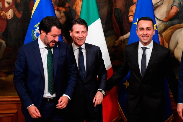 Italy's new prime minister, Giuseppe Conte, centre, poses with his deputy prime ministers Luigi Di Maio of the Five Star party, right, and League leader Matteo Salvini at the Chigi Palace in Rome. Photo: Claudio Peri/AP