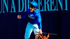 William Buick ridding Masar celebrates winning the Investec Derby at Epsom yesterday. Photo: Warren Little/Getty Images