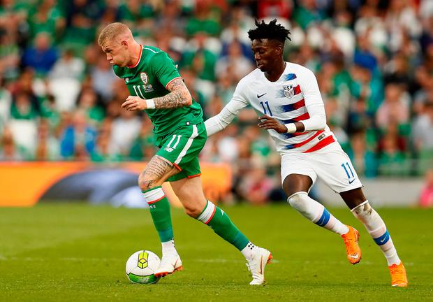 Ireland's James McClean in action with USA's Timothy Weah. Photo: Jason Cairnduff/Reuters