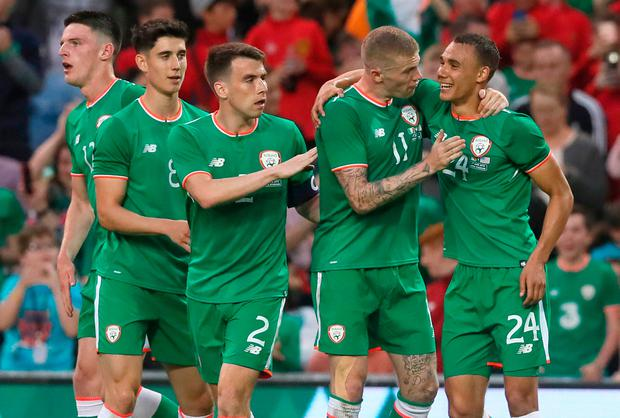 Ireland's Graham Burke (right) celebrates scoring his side's first goal of the game. Photo: Brian Lawless/PA