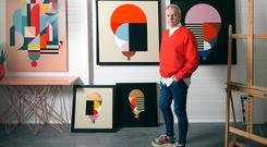 John Redmond with a selection of his paintings. Photo: David Conachy