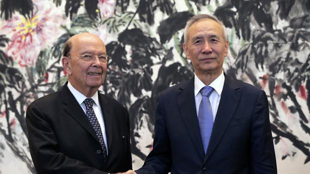 U.S. Commerce Secretary Wilbur Ross, left, shakes hands with Chinese Vice Premier Liu He (Andy Wong/AP)