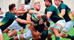 Ireland's number 8 and captain Caelan Doris (C) scores a try during the World Cup U20 championship match between South Africa and Ireland in Narbonne