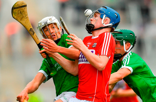 Cian McCarthy of Cork has his eyes firmly on the ball as Limerick's Diarmuid Hegarty (left) and Patrick Kirby tackle him during Saturday's Munster MHC clash. Photo: Sportsfile