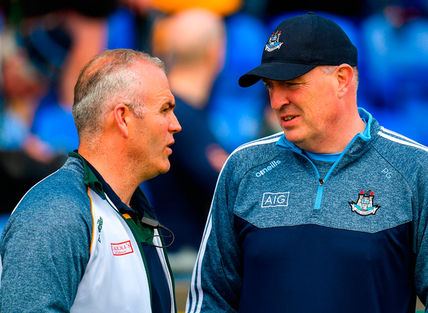 Offaly boss Kevin Martin and Dublin's Pat Gilroy. Photo: Sportsfile