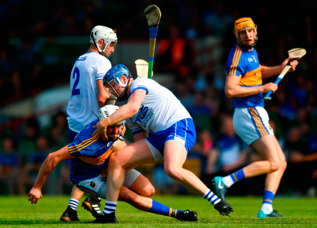 Austin Gleeson of Waterford tangles with Patrick Maher of Tipperary during the Munster GAA Senior Hurling Championship Round 3 match between Waterford and Tipperary at the Gaelic Grounds in Limerick. Photo: Sportsfile