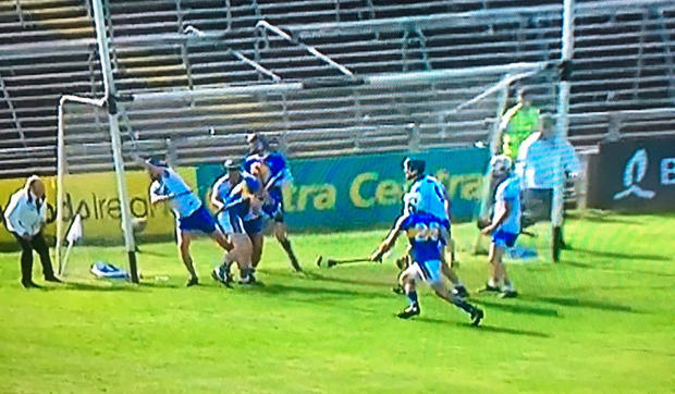 Umpires have contrasting views: Austin Gleeson keeps the ball out of the Waterford net, however it is the umpire on the opposite side of the goal that raises his green flag.