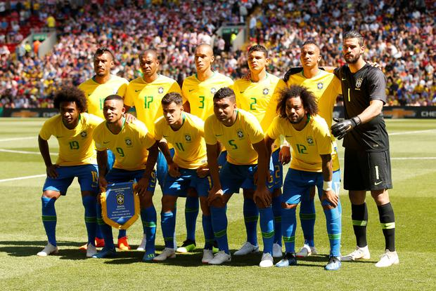 Brazil players pose for a team group photo before the match. Photo: Reuters