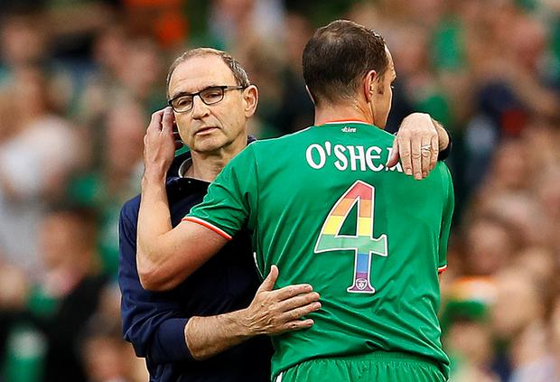 Ireland's John O'Shea with manager Martin O'Neill as he is substituted. Photo: Reuters