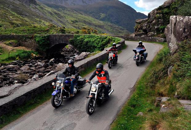 Bikers Michael Thompson, Mark Astle, Mark Ozzie Taylor and Ralph Zirkinitzer ride their Harley-Davidson motor bikes through the Gap of Dunloe, Killarney, Co Kerry, during Ireland Bikefest which took place this weekend. Harley-Davidsons were among the first products to be hit with EU tariffs. Photo: Don MacMonagle
