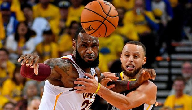 Golden State Warriors guard Stephen Curry (30) and Cleveland Cavaliers forward LeBron James (23) go for a loose ball during the second quarter in game one of the 2018 NBA Finals at Oracle Arena. Credit: Kyle Terada-USA TODAY Sports