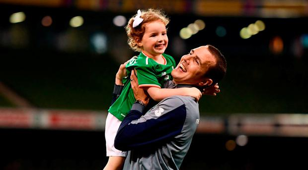 John O'Shea of Republic of Ireland plays with his daughter Ruby following the International Friendly match between Republic of Ireland and the United States at the Aviva Stadium in Dublin. Photo by Stephen McCarthy/Sportsfile