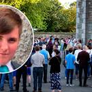 Mourners at a vigil for Cameron Reilly (inset) earlier this week