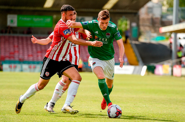 Garry Buckley of Cork City in action against Darren Cole of Derry City. Photo by Eóin Noonan/Sportsfile
