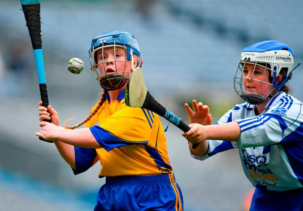 Sophie Doyle of St. Clare's PS in Harold's Cross, Dublin, in action against Lauren McKeever (Holy Rosary PS, Ballycragh, Dublin) during the Corn Olly Quinlan Shield in Croke Park. Photo: Sportsfile