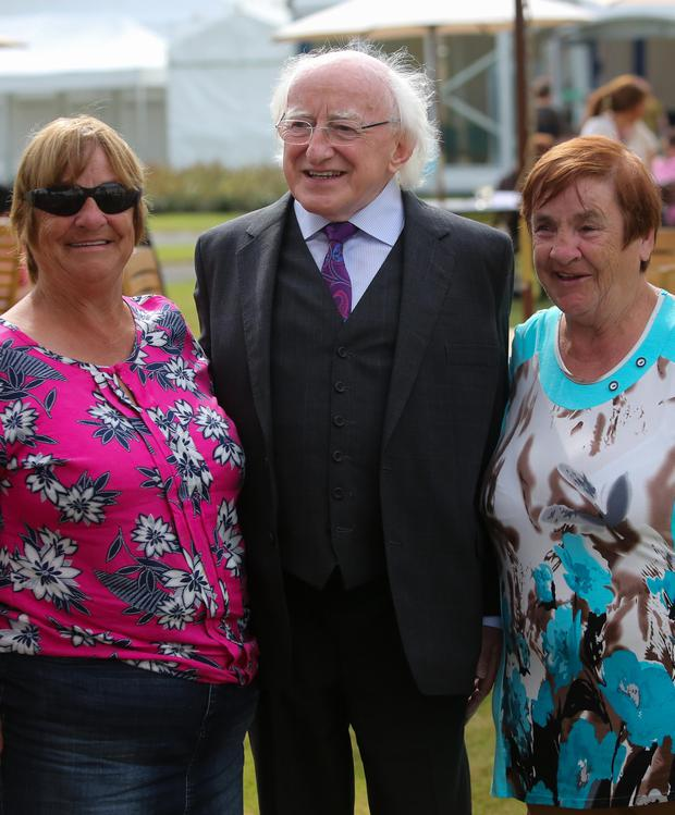 (L - R) Mairead Manley and Breeda Kennedy, who attended Goldenbridge, with President Michael D Higgins Photo: Gareth Chaney Collins