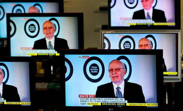 Chairman, and Chief Executive of News Corporation, Rupert Murdoch is seen talking on Sky News on television screens in an electrical store in Edinburgh. REUTERS/David Moir/File Photo
