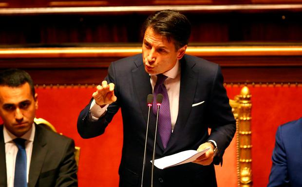 Newly appointed Italian Prime Minister Giuseppe Conte speaks during his first session at the Senate in Rome. REUTERS/Alessandro Bianchi
