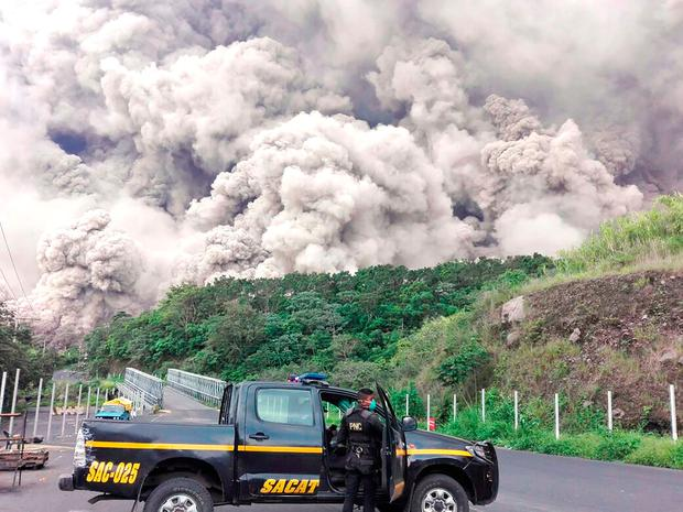 Guatemalan policemen during search operations around Volcano Fuego after an eruption. Photo: HO/AFP/Getty Images