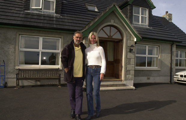 George and Alex Best outside their seaside retreat home.