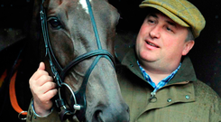 Trainer Paul Nicholls with his Cheltenham Gold Cup winner Denman at his stables in Somerset. Denman died on Tuesday at the age of 18. Photo: Barry Batchelor/PA