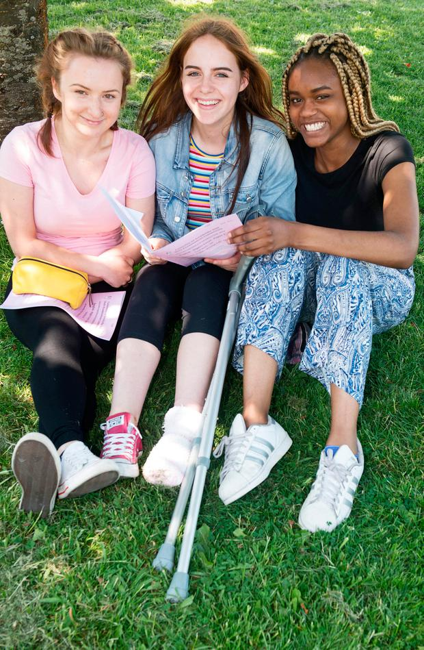 LEFT: Leaving Cert students Kamila Sadowska, Cathleen Green and Chidera Ifeagwu after sitting English Paper 1 at St Enda's in Galway. Photo: Andrew Downes