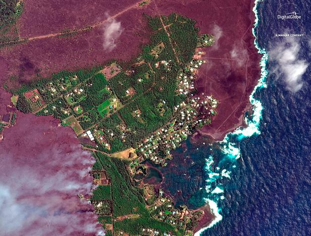 This satellite image provided by Digital Globe captured June 3, 2018, shows advancing lava flows as they approach Kapoho Bay in Hawaii. (Satellite Image ©2018 DigitalGlobe, a Maxar company via AP)