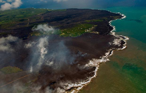 Most of the Kapoho area is now covered in fresh lava as the Kilauea Volcano lower east rift zone eruption continues on Wednesday, June 6, 2018, in Pahoa, Hawaii. (AP Photo/LE Baskow)