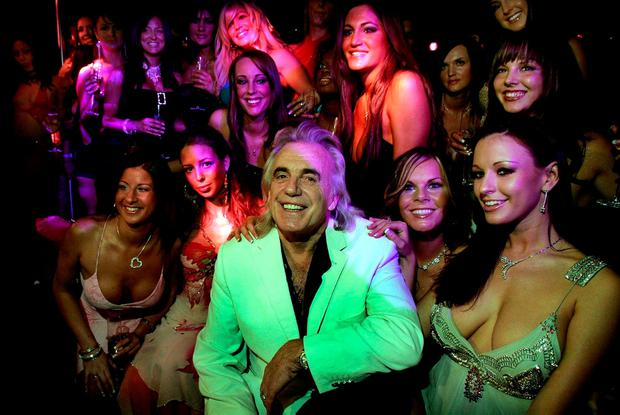 Peter Stringfellow with some of his Dublin club's dancers in 2006. Photo: Steve Humphreys