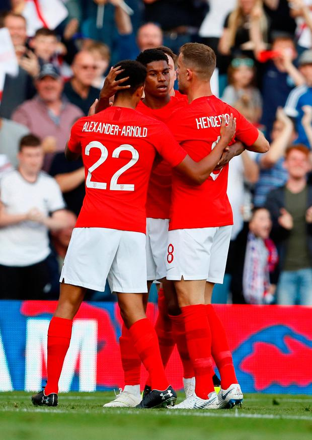 England's Marcus Rashford celebrates scoring their first goal with teammates