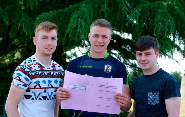 Galway minor hurling team members Donal Mannion, Ronan Glennon and Conor Molloy from St Brigid's College, Loughrea, with their Engineering exam. Photo: Hany Marzouk