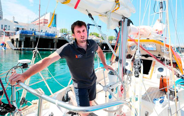Adventurer Gregor McGuckin on his yacht Hanley Energy Endurance in Dun Laoghaire harbour before he sets off on the Golden Globe solo round the world race. Photo: Niall Carson/PA